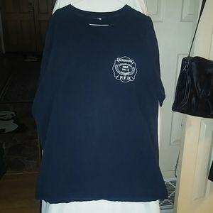 T shirt with Portland Fire Dept logo. Size L
